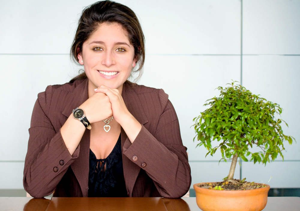 Business woman portrait smiling in an office - hispanic
